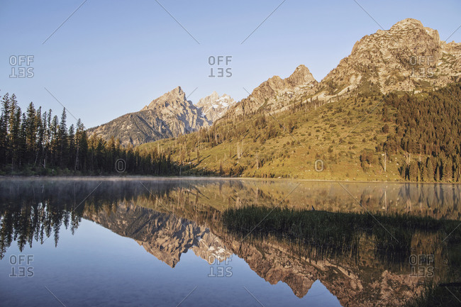 Jagged peaks of Grand Teton National Park reflected in String Lake