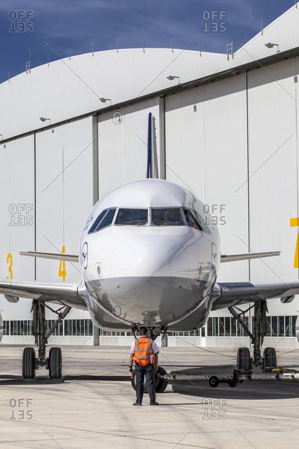 Luqa, Malta - September 29, 2012: Operator tows a civil aircraft at maintenance hangar in Luqa Malta