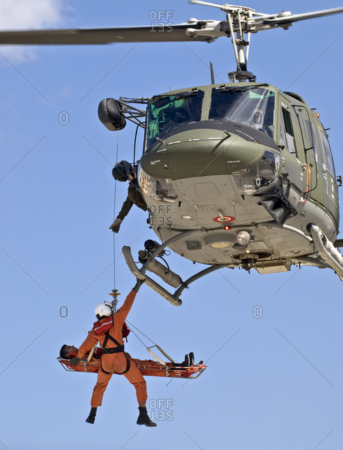 Luqa, Malta - October 5, 2008: Military helicopter crew carrying out medevac