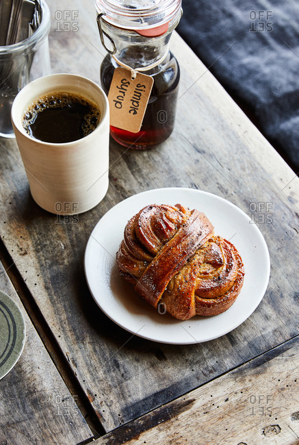 Pastry served with coffee on rustic wooden table