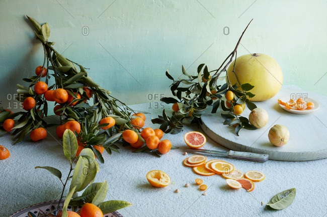 Variety of fruit being prepared on light background