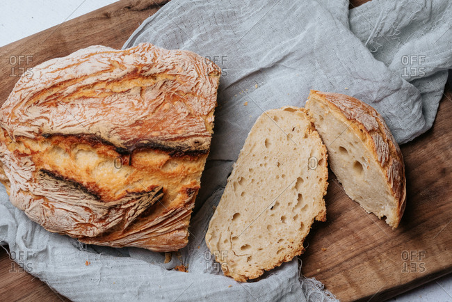 Homemade artisan bread sliced on a cutting board