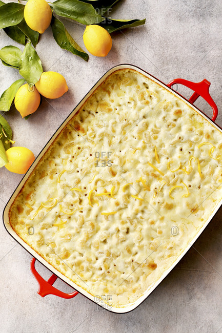 Meyer lemon mac and cheese on light background with lemons