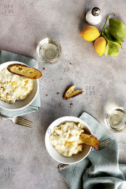 Meyer lemon mac and cheese served with crostini and wine