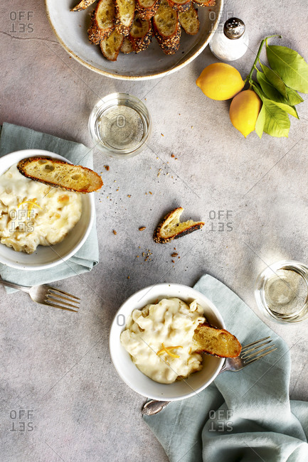 Meyer lemon mac and cheese served with bread and wine
