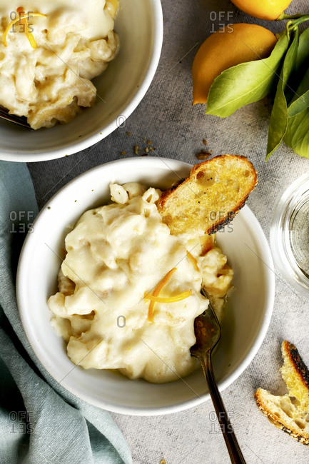 Top view of Meyer lemon mac and cheese served with bread