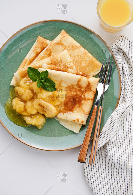 Overhead view of crepes with caramelized bananas for breakfast
