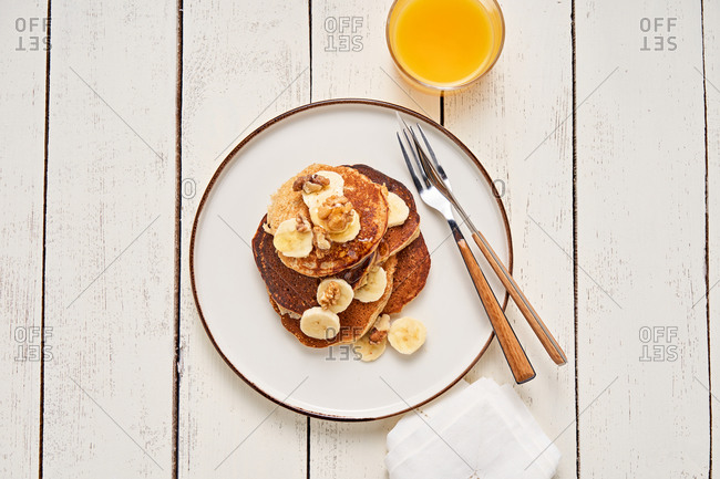 Banana pancakes with walnuts and maple syrup