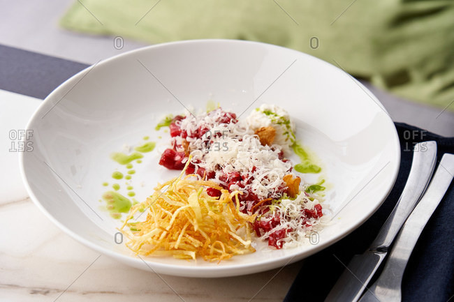 Free range beef tartare, parmesan mousse and parsley oil