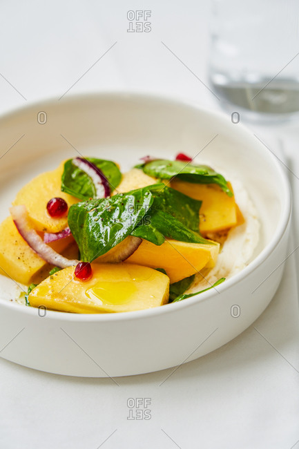 Whipped cheese topped with fruit and vegetable salad