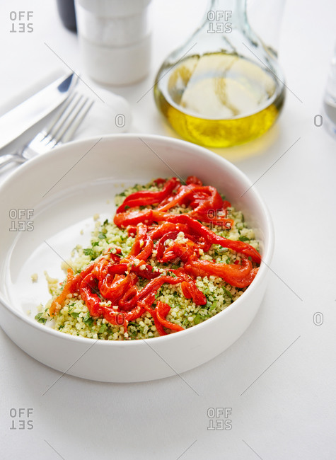 Healthy herbed couscous salad with roasted bell peppers
