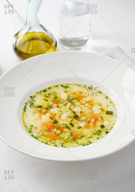 Healthy and nutritious Italian minestrone soup on white table