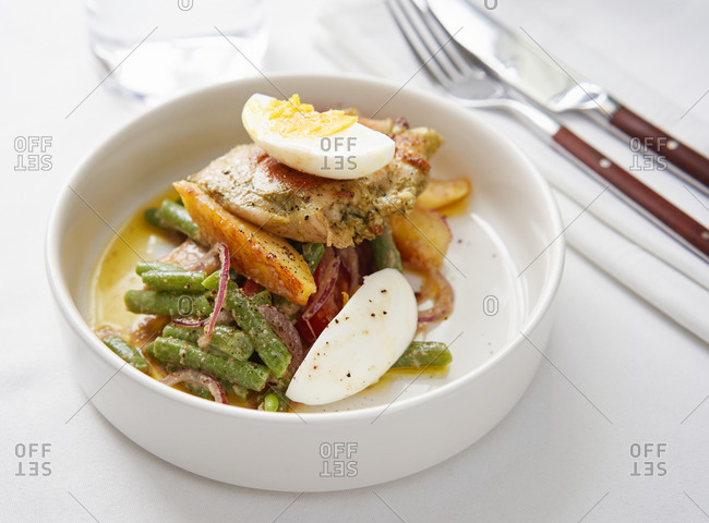 Grilled chicken breast served with baked vegetables and a soft boiled egg