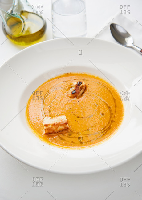 Delicious creamy carrot soup with croutons and olive oil