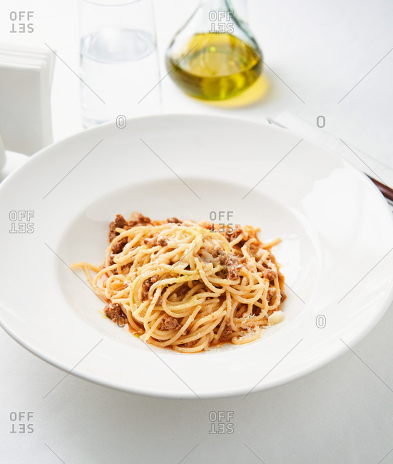 Italian dish of spaghetti bolognaise with minced beef and tomato sauce