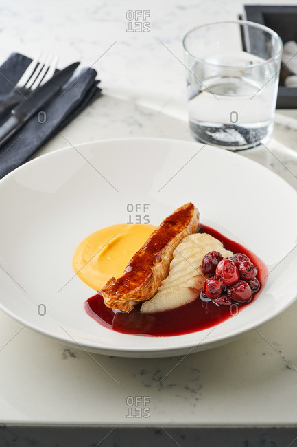Glazed turkey fillet with sweet potatoes and cherry sauce