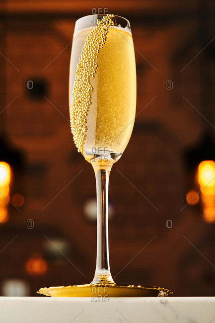 Yellow champaign cocktail with calvados