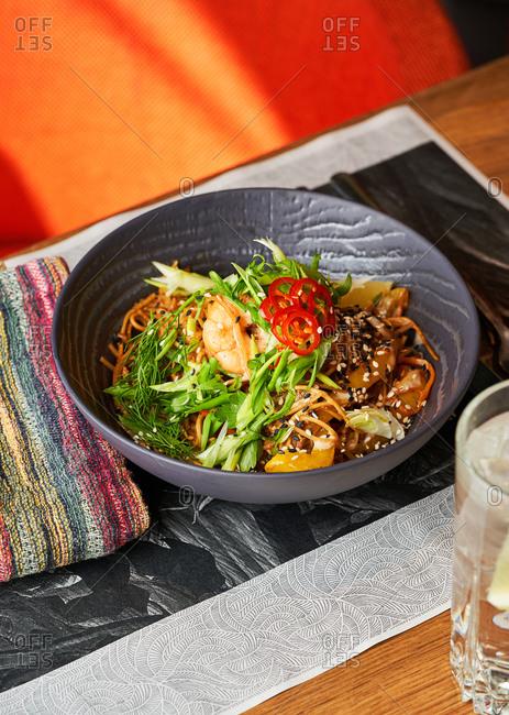 Stir fried noodles with shrimps and vegetables