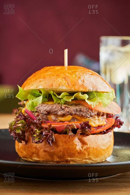 Classic American cheddar cheeseburger in brioche homemade hamburger bun