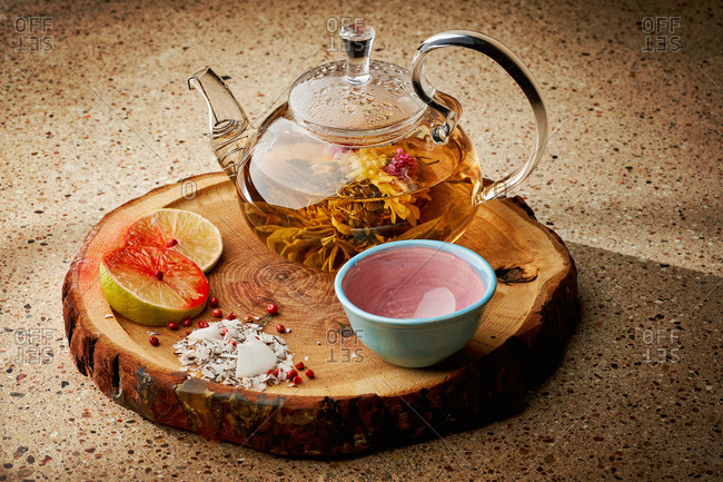 Celebration teapot for blooming green tea on wooden board