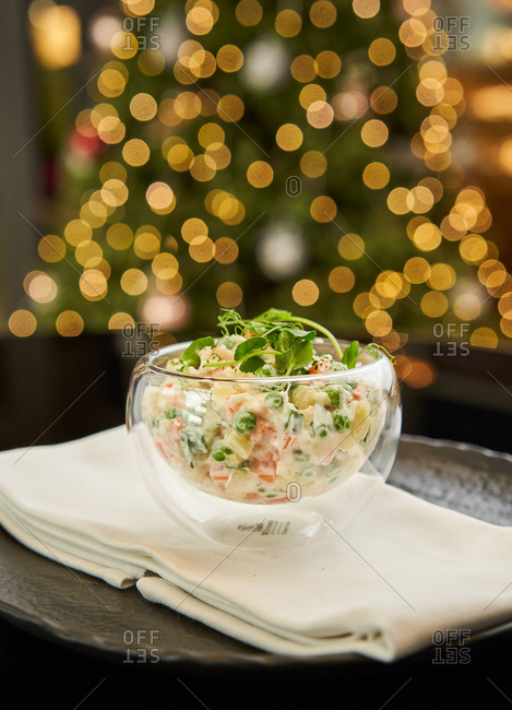Traditional Russian festive salad Olivier on glittering background