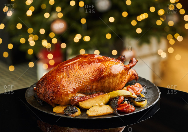 Juicy oven roasted duck served with apples