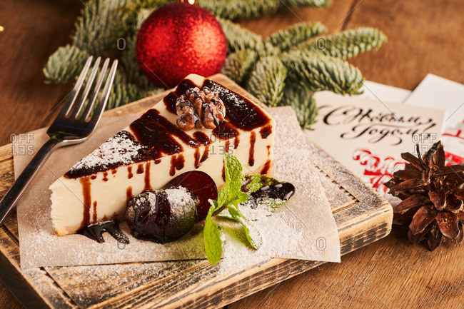 Toffee and chocolate topped cheesecake served in festive setting