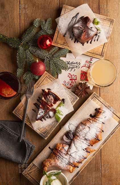 Top view of assorted Christmas desserts on wooden table