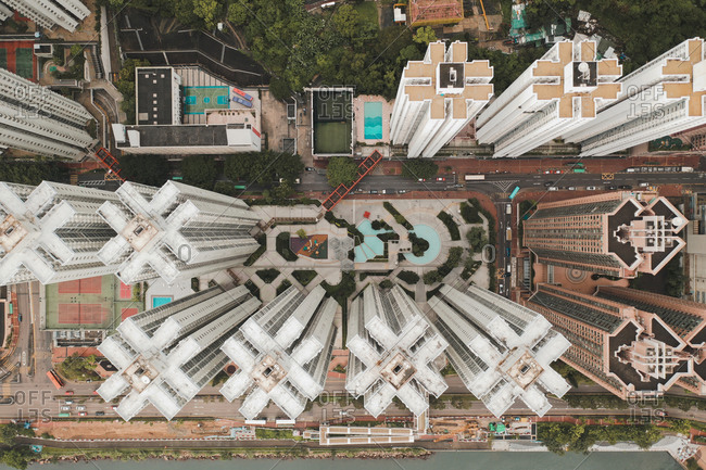 Aerial view of tall apartments in a unique perspective in Hong Kong.