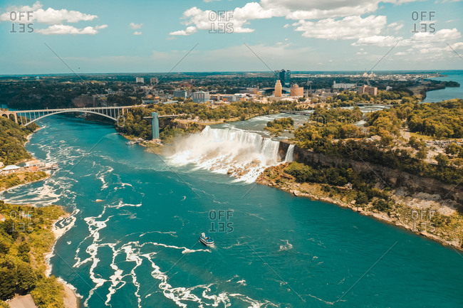 Aerial view of Niagara falls of the US side with bridge.