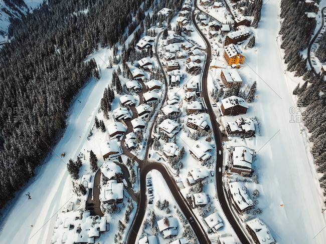 Aerial view of chalets in les trois vallees during winter, France.