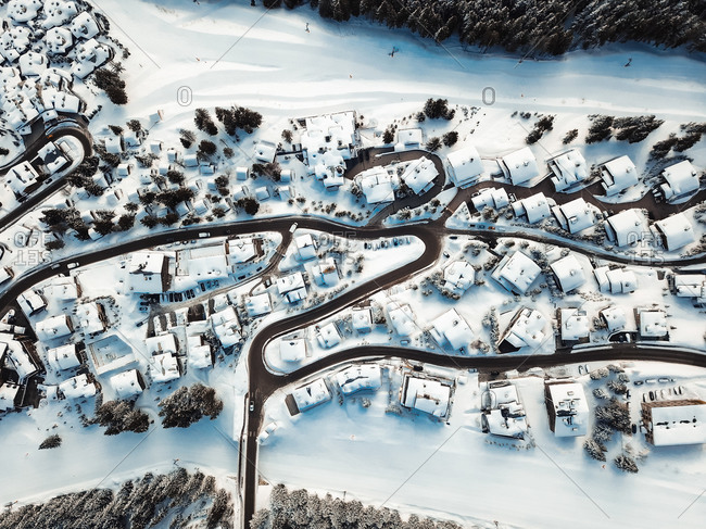 Aerial view of chalets in les trois vallees during winter, in France.
