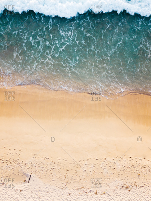 Aerial view of sandy beach with wave in Lampuuk, Aceh, Indonesia.