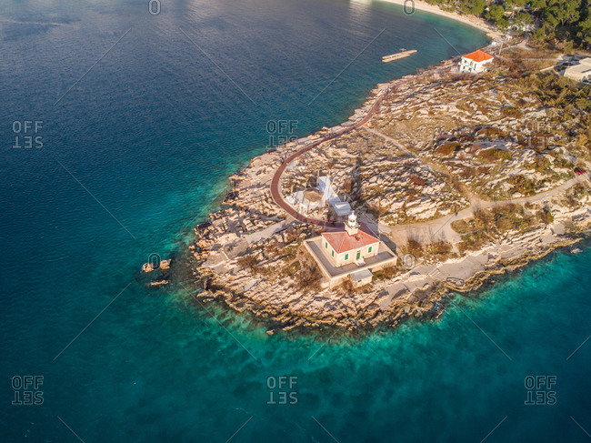 Aerial view of famous lighthouse and Adriatic sea coastline in the city of Makarska in Dalmatia, Croatia. Lighthouse is situated on the St. Peter peninsula.