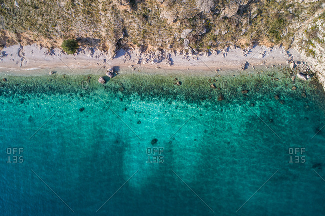 Aerial view of popular landmark Vruja near Makarska with Biokovo mountain and Adriatic sea. One of the most scenic places on the main road between Split and Dubrovnik in Dalmatia, Croatia.