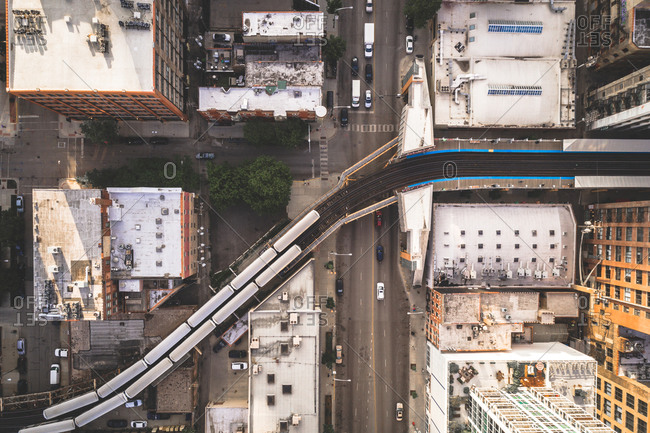 March 27, 2020: Aerial view of a train crossing over empty streets due to the corona virus pandemic at Chicago, United States.
