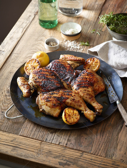 Spatchcock chicken platter on a rustic wooden table