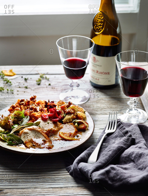 Thanksgiving dinner served on a rustic table with red wine