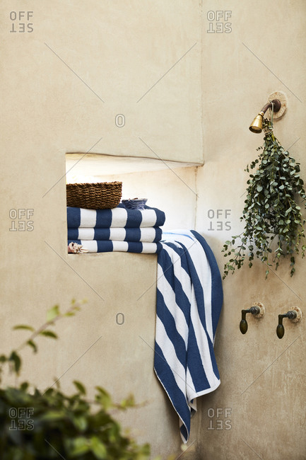 Blue striped towels in spa shower