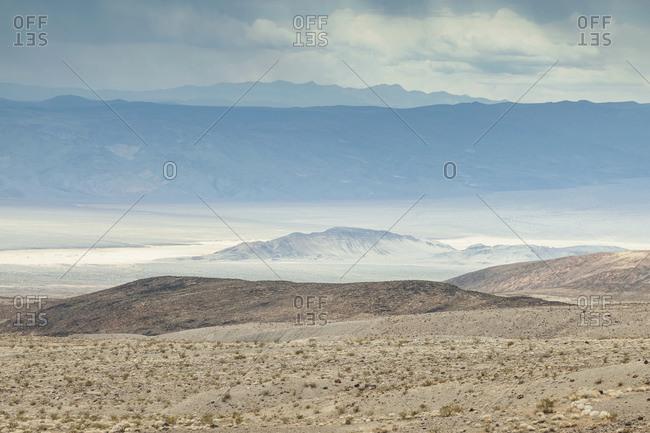 Vast desert hills under cloudy sky