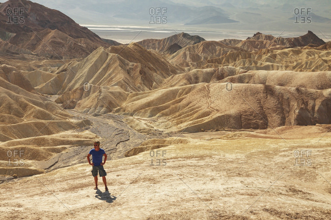 Man hiking on desert hills