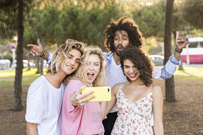 Happy friends taking a selfie outdoors