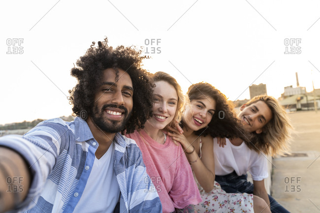 Portrait of happy friends outdoors