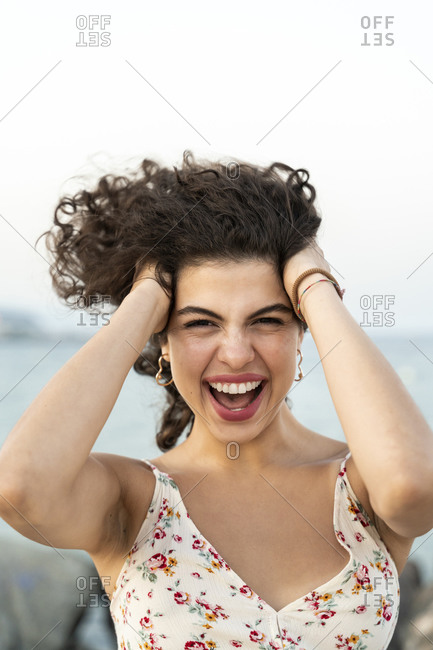 Portrait of excited young woman outdoors