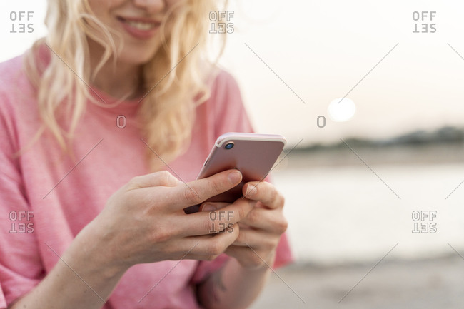 Close-up of young woman using smartphone outdoors