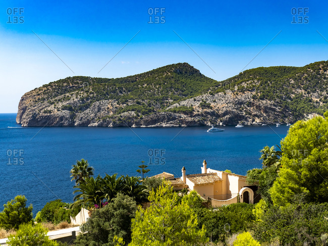 Spain- Balearic Islands- Camp de Mar- Clear sky over forested bay in summer