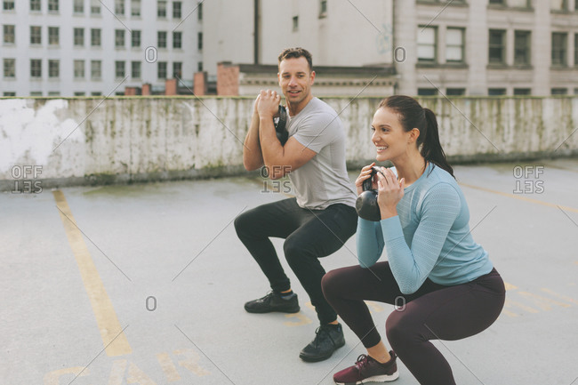 Man and woman exercising in the city- Vancouver- Canada