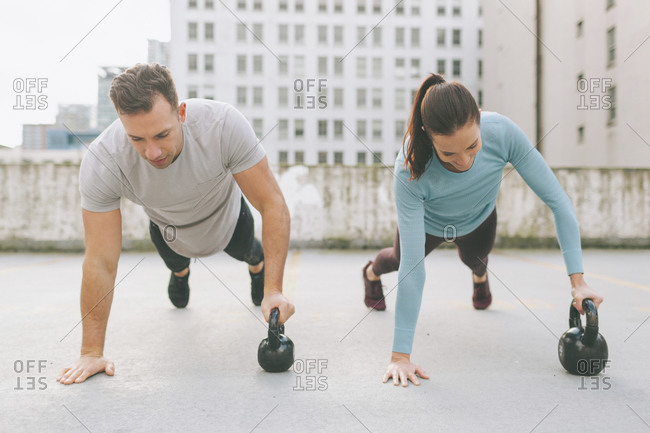 Man and woman doing push ups in the city- Vancouver- Canada