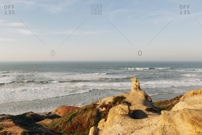 Portugal- Peniche- Clear line of horizon over Atlantic Ocean seen from coastal hill