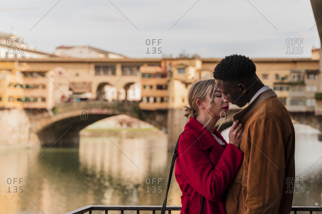 Affectionate young couple kissing in the city of Florence- Italy